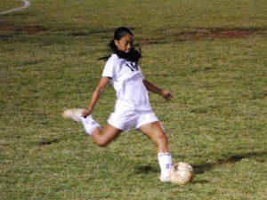 Kaisha playing soccer